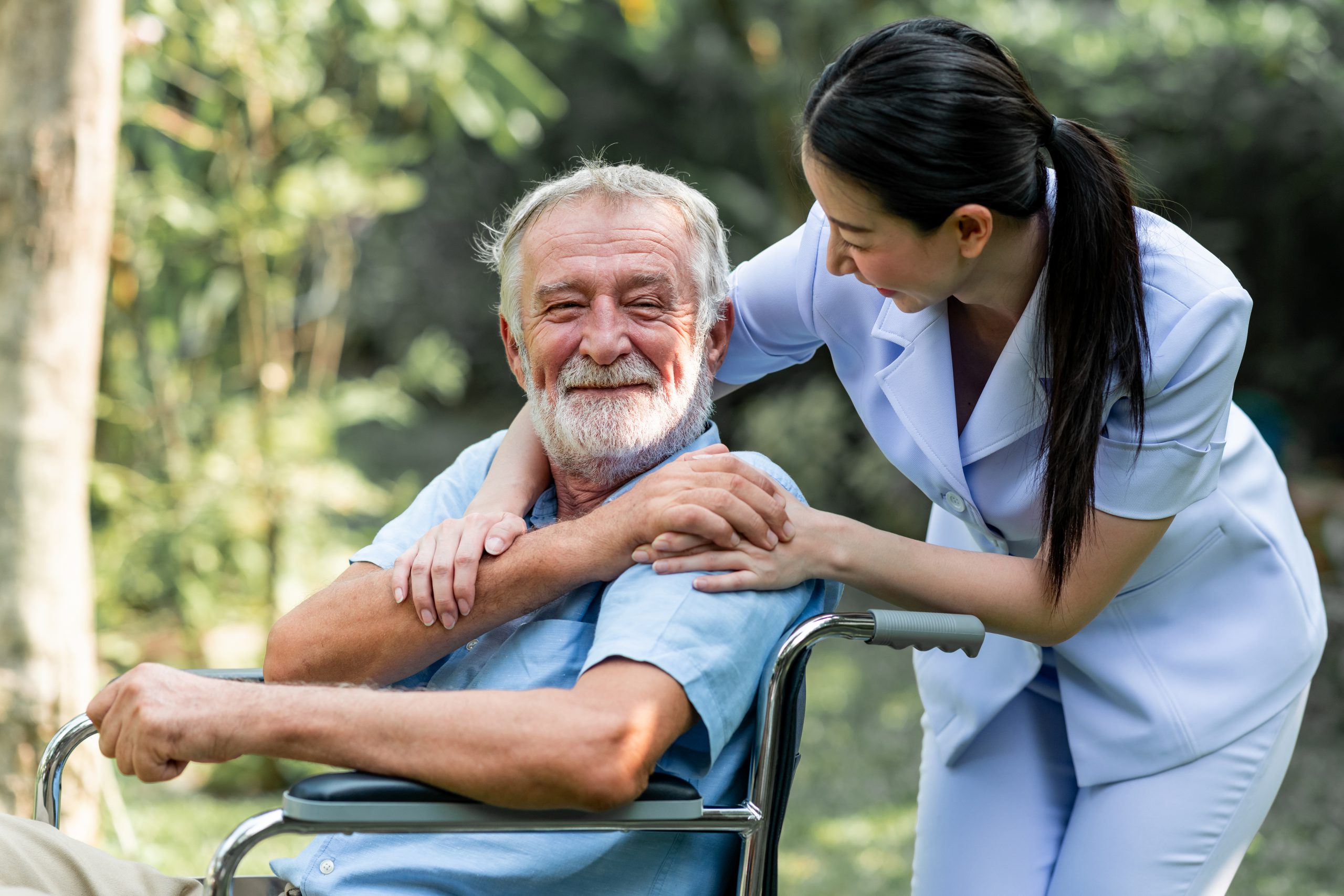 a healthcare worker comforts an older patient