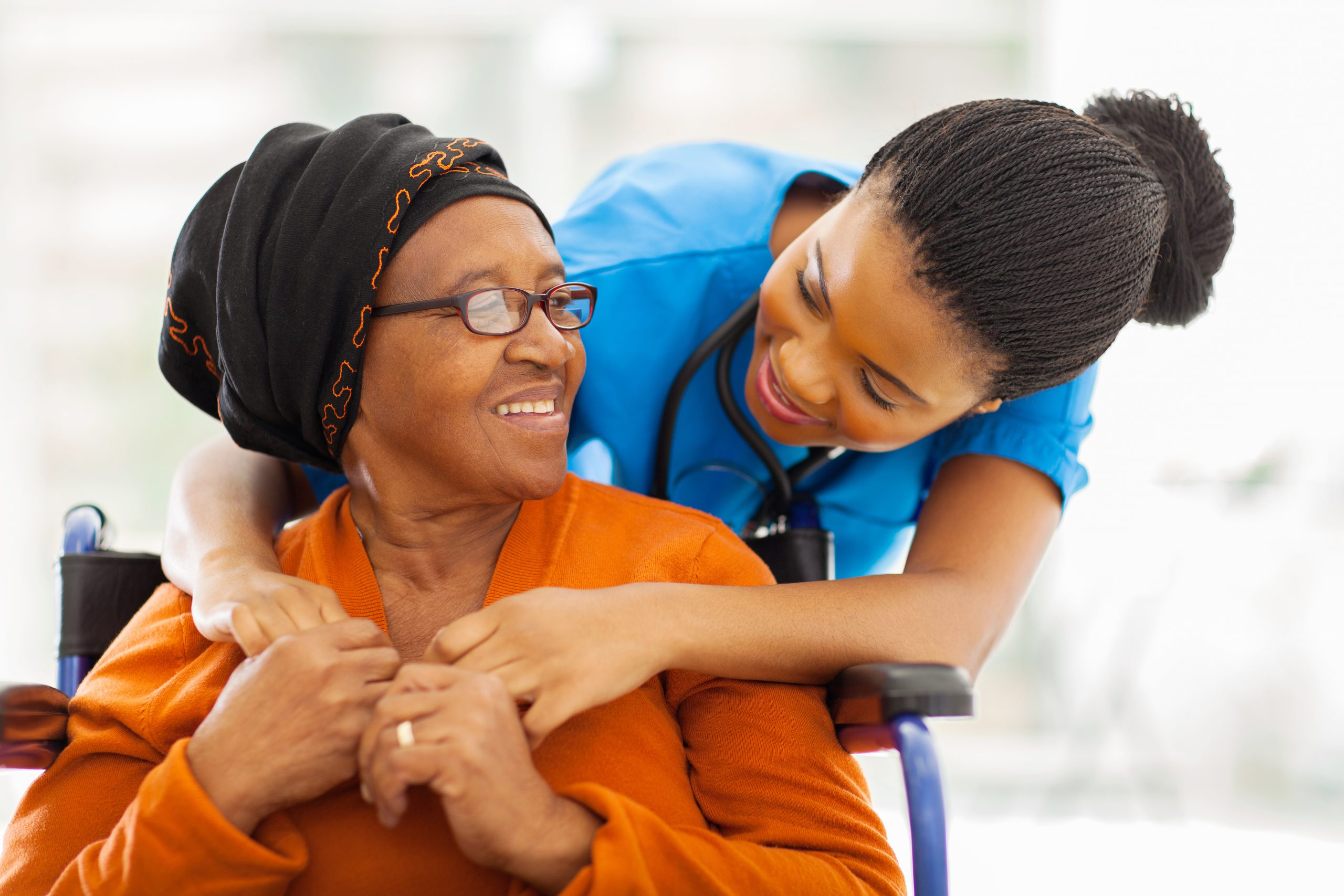 a healthcare worker comforts a patient