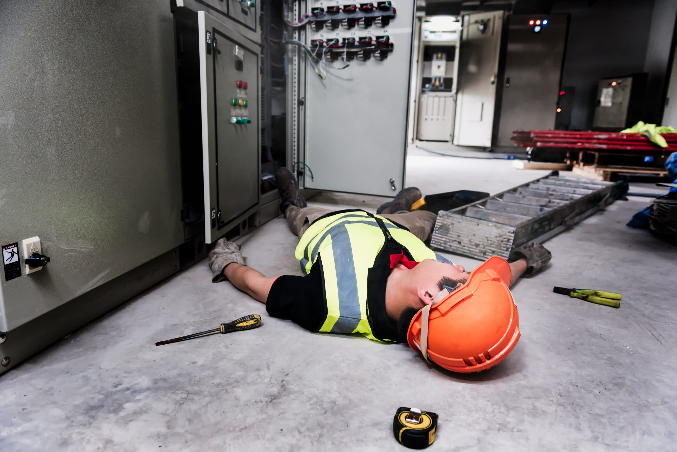 a construction worker lies on the floor