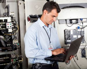 a man inspects something on his laptop